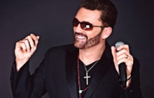 Johnny Mack as George Michael