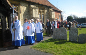 Procession reaches the church